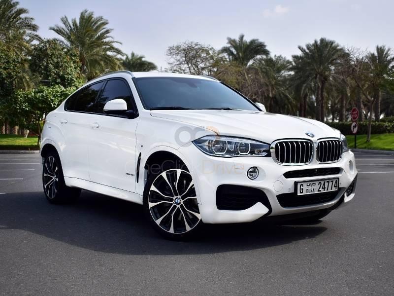 Rent BMW X6 M50 in Dubai - SUV Car Rental